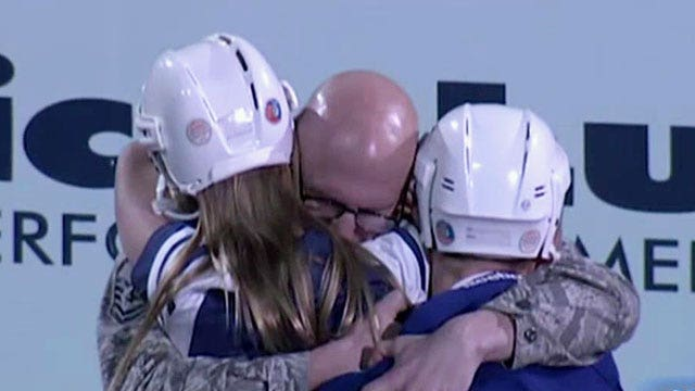 Air Force dad surprises kids at hockey game