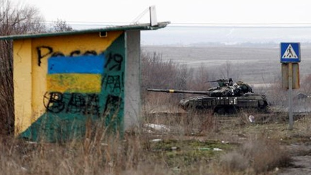 Ukraine's military exchanges fire with rebel forces