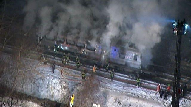Raw: Metro-North train hits car on tracks