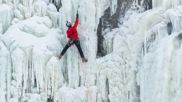 Ice climber becomes first to ascend frozen Niagara Falls