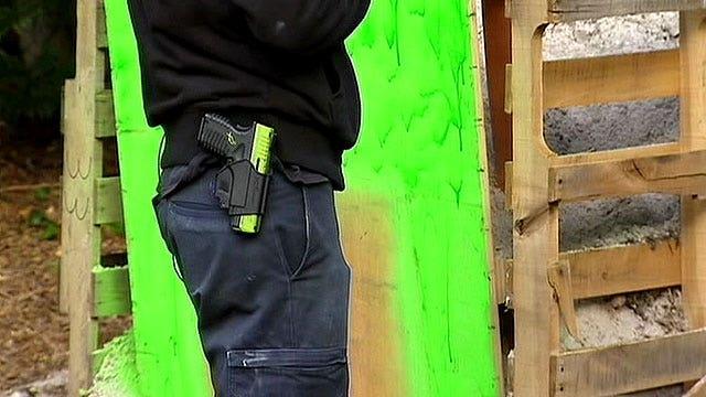 Neighbors outraged after man builds backyard gun range