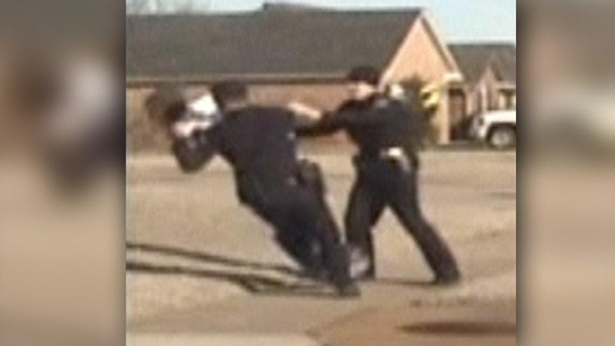 Raw video: Alabama cop accused of badly injuring man visiting relatives