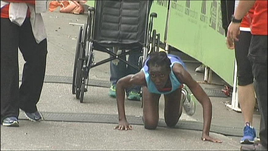 With nurses by her side, she crawled inch-by-inch to the finish line. If anyone helped her, Hyvon Ngetich would have been disqualified.