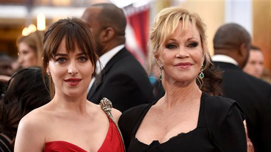 Melanie Griffith and Dakota Johnson argue on the red carpet