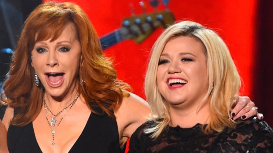 Reba McEntire stands up for daughter-in-law, Kelly Clarkson