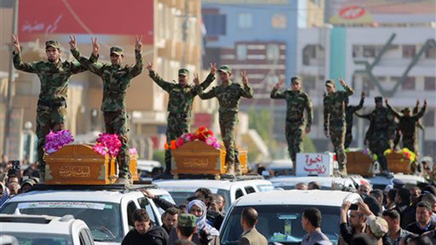 Iraqi, Iranian forces close in on Saddam Hussein's hometown