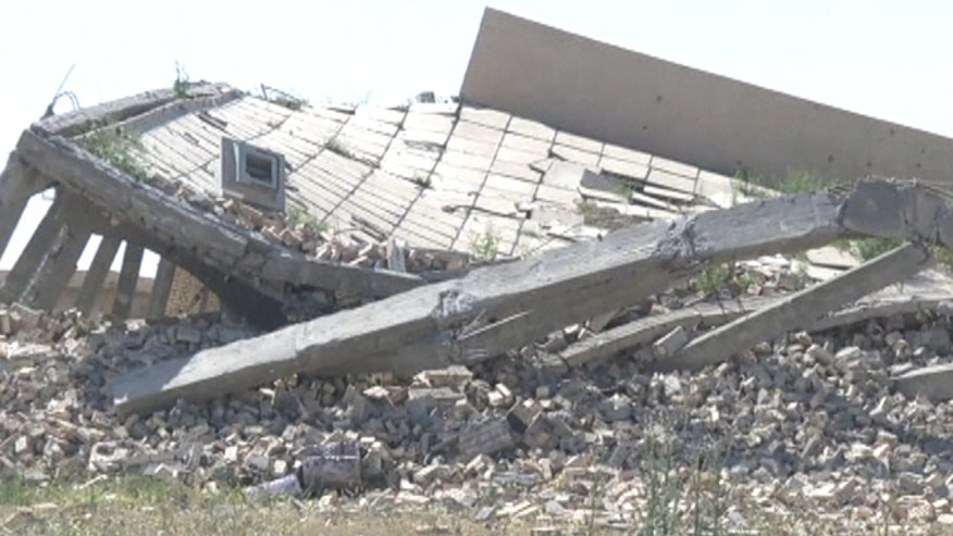 Clashes between Iraqi forces and ISIS nearly levels former dictator's mausoleum in Tikrit