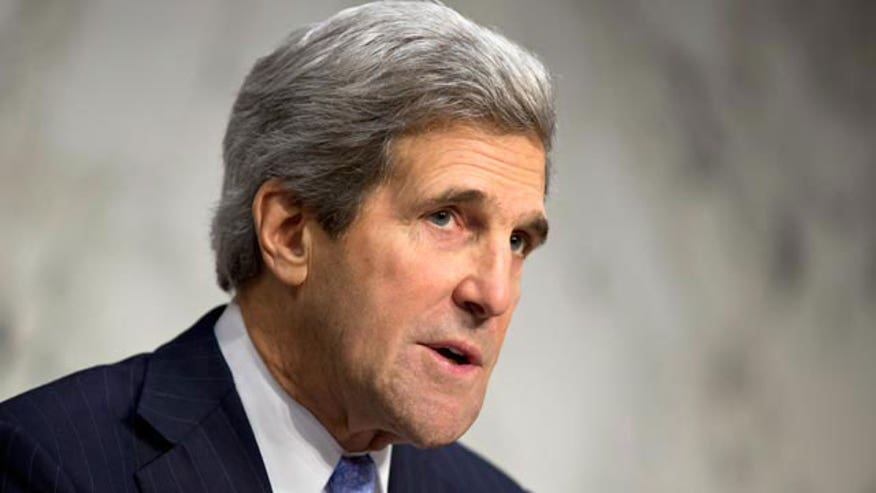 John Kerry negotiating with Iran to stop the mullahs from developing a nuclear weapon