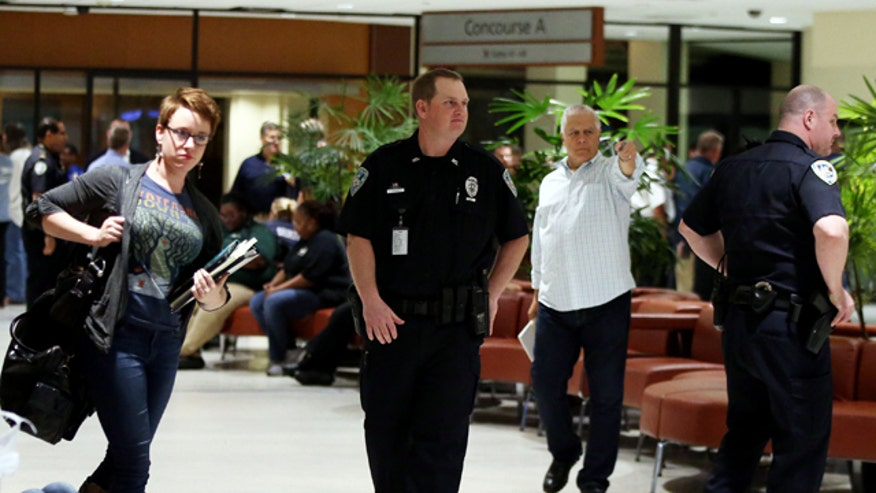 A machete-wielding man was shot after attacking several passengers and TSA agents