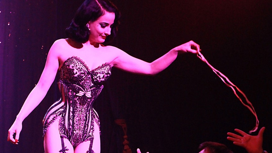 Legendary burlesque star Dita Von Teese shares how she feels about using a corset to get back in shape.
