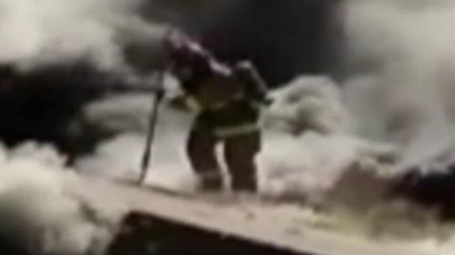 Firefighter Falls Through Roof Of Burning Home Latest