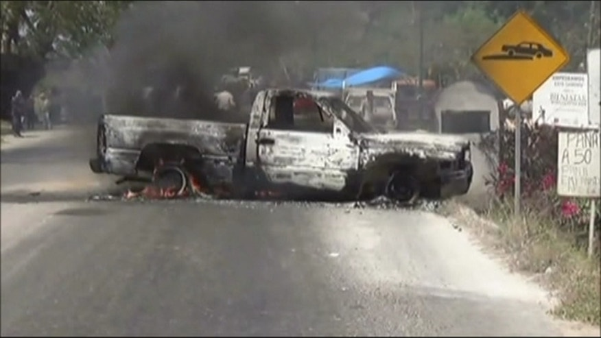 Attack on police convoy leaves at least 15 dead