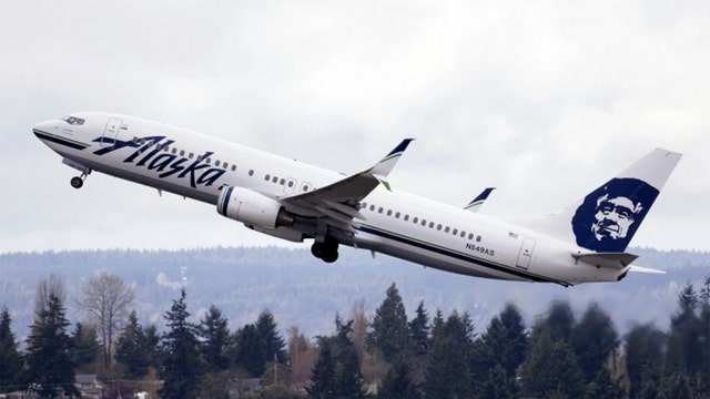 Alaska Airlines bans trapped worker from handling its flights as 911 call released