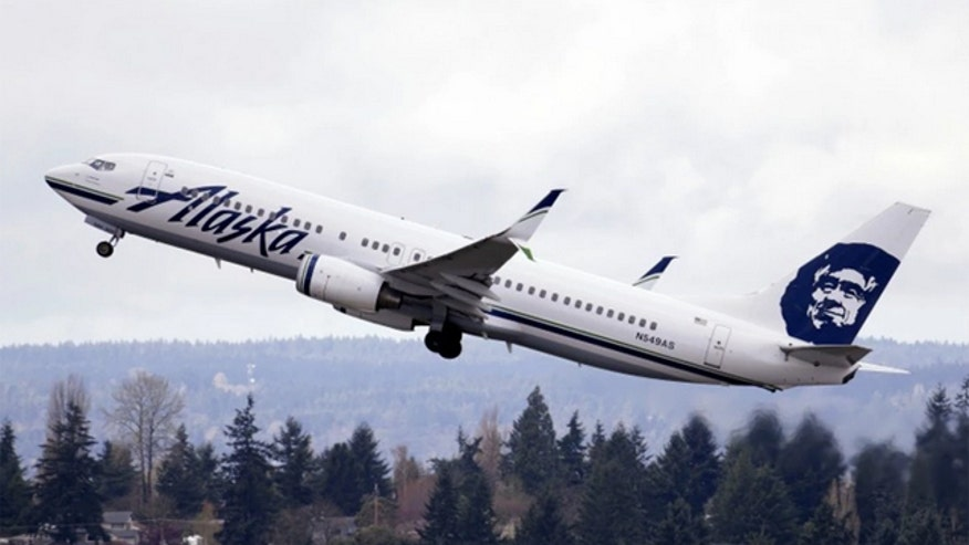 Alaska Airlines baggage handler who fell asleep on job calls for help after plane takes off
