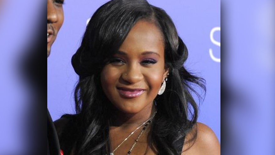 Bobby Brown announces at concert that his daughter is 'awake'