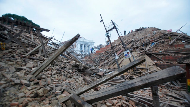 At least 1,180 killed as 7.8 magnitude earthquake hits Nepal; search for survivors
