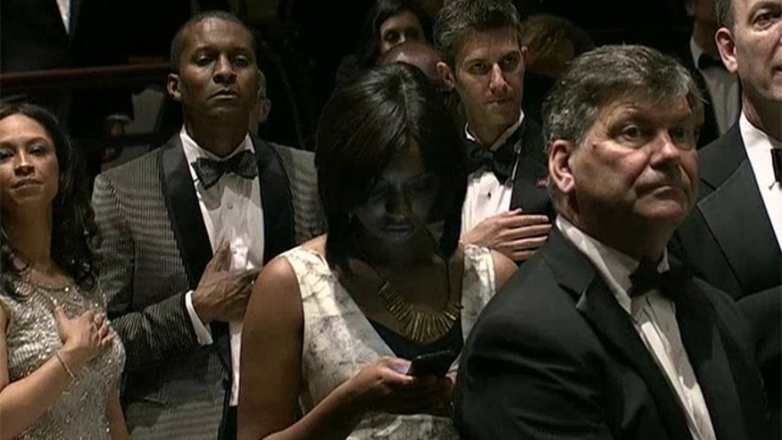 Washington post reporter on her phone during the National Anthem at the White House Correspondents Dinner