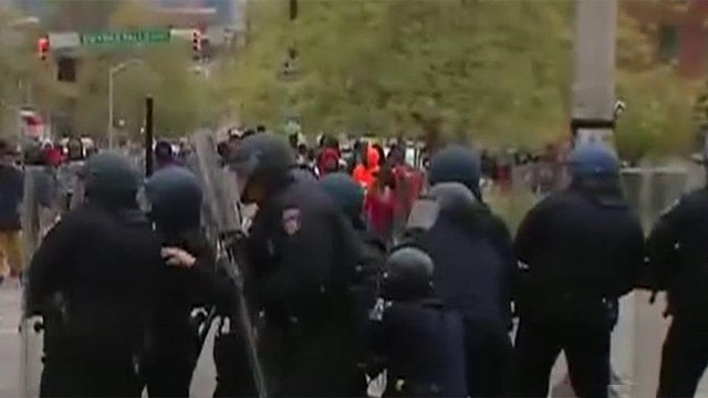 Juveniles pelt Baltimore police with rocks; police retaliate