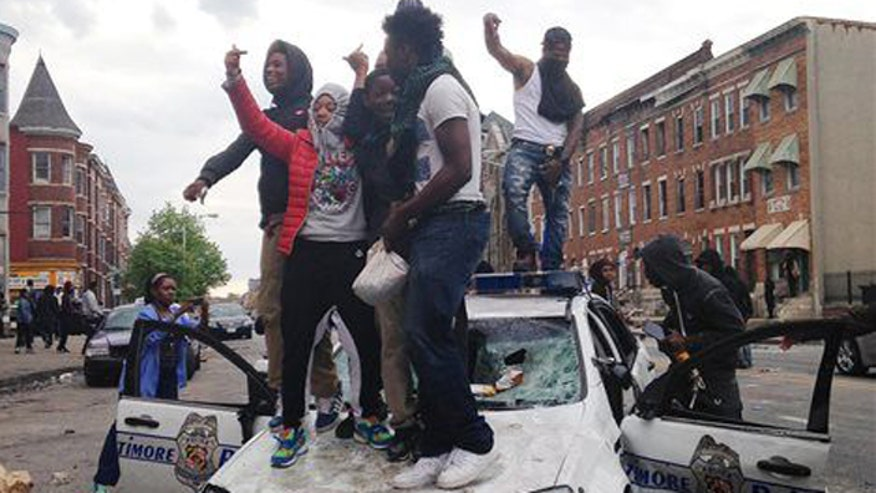 Many were baffled at police stand by as looters sets cars on fire, hurled bricks at onlookers. Was enough done by law enforcement? Were their hands tied? #BaltimoreRiots