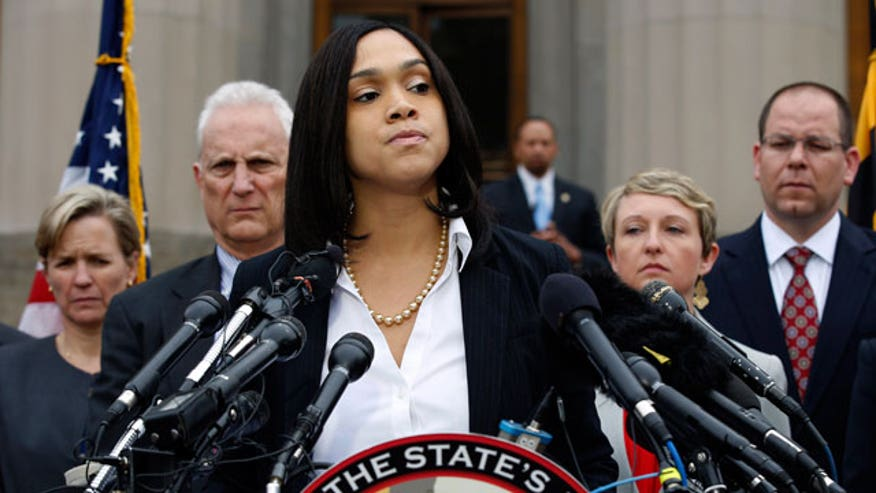 Six police officers charged in death of Freddie Gray