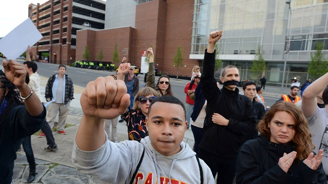 Baltimore protesters breathe sigh of relief after officers charged in Freddie Gray's death