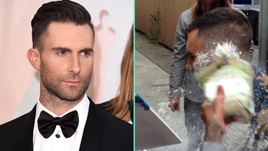 Maroon 5 lead singer covered in white stuff outside 'Kimmel'