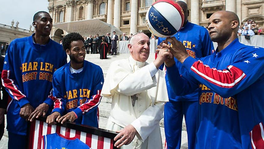 Pope Francis becomes honorary Harlem Globetrotter