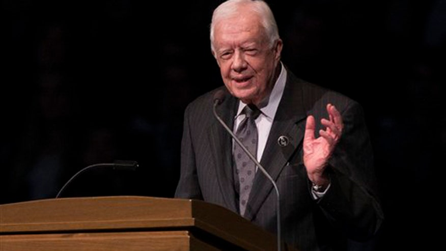Former President Jimmy Carter feeling ill, returns to Atlanta