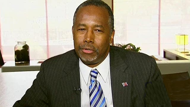 Ben Carson reacts to surging ahead in the polls