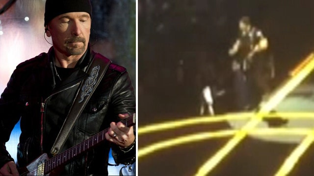 U2's The Edge topples off edge of stage during concert