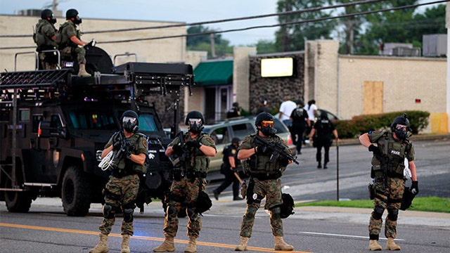 President Obama bans some military equipment for police