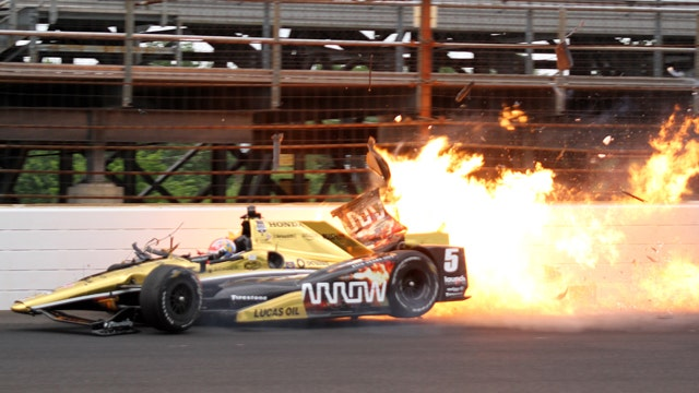 Indy car bursts into flames after wreck during practice