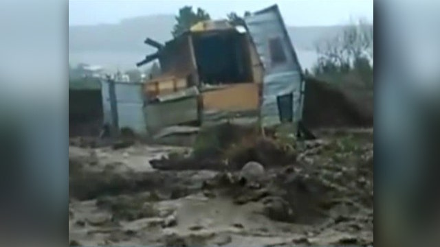 Raging floodwaters sweep away homes in Chile