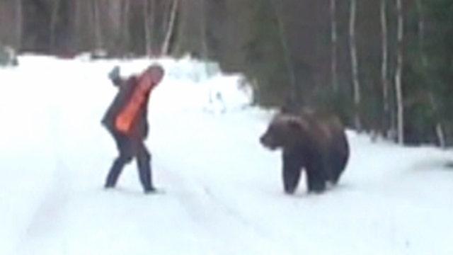 Man's roar scares off charging bear