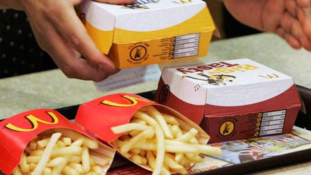 Who ultimately pays for a wage hike at McDonald's?