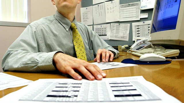 Sitting and standing at work kills, experts say