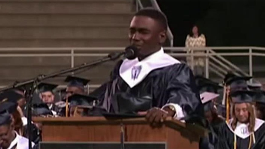 Student leads crowd in prayer at high school graduation