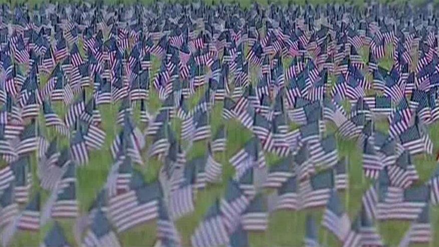 Community places thousands of flags on baseball field