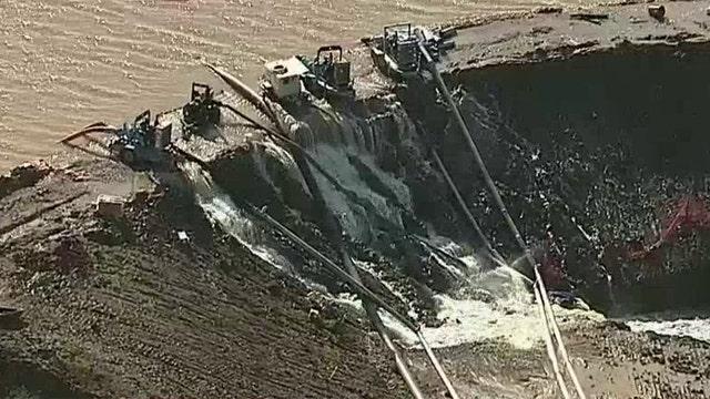 Dam breaches in Dallas suburb amid historic flooding