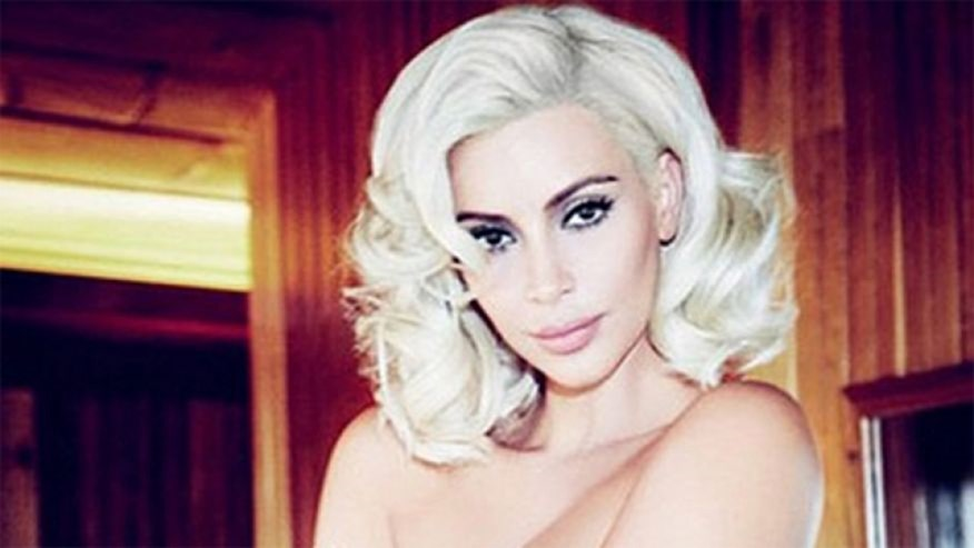 Kardashian goes blonde bombshell on mag cover