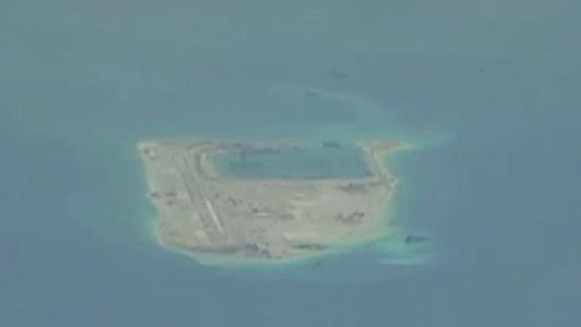 Chinese artillery spotted on fake reef near disputed island