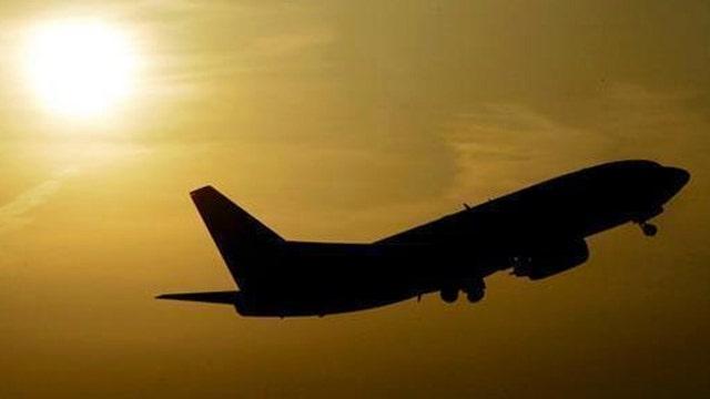 Raw video: Passengers on flight burst into song