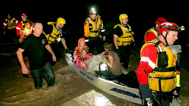 Rescue crews pull dozens of people from floodwaters in Texas