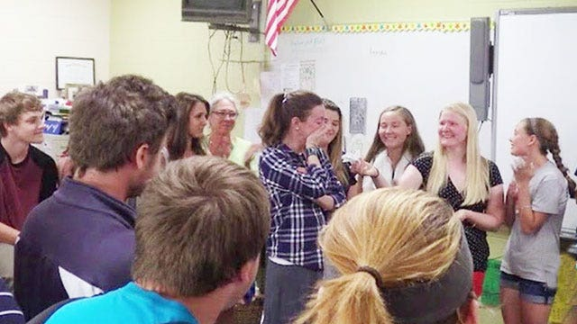 Students cancel trip, give cash to principal battling cancer