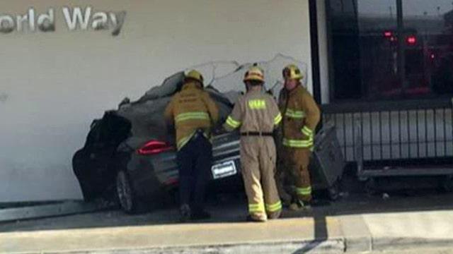Car slams into LAX terminal, 9-year-old girl critically hurt