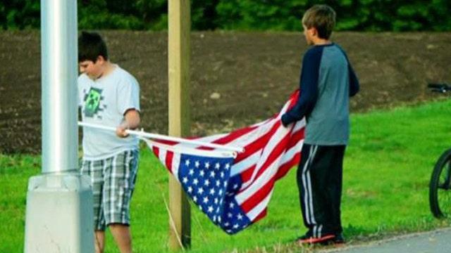 Proud American: Patriotic boys rescue American flag