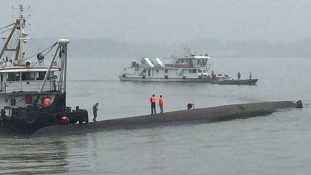 Rescuers working to save people aboard sunken Chinese ship