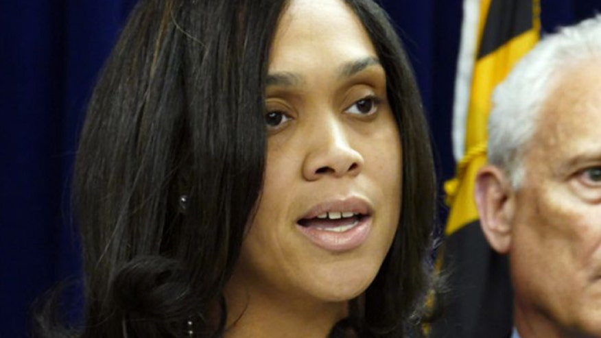 Lawyer for charged officer believes Baltimore state's attorney is trying to hide something