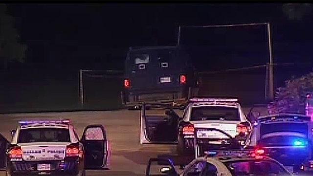 Gunman dead after firing on Dallas police outside headquarters