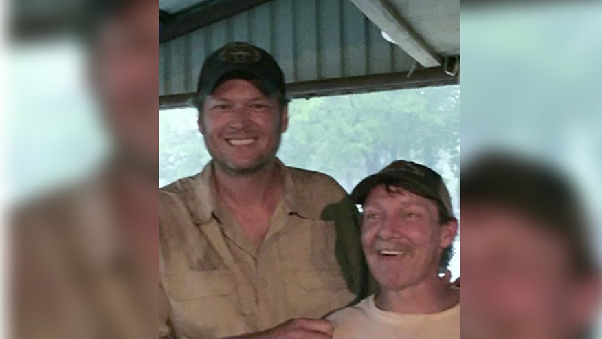 Country star saves man stranded in floods